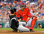 9 July 2011: Washington Nationals catcher Jesus Flores gets Colorado Rockies right fielder Ryan Spilborghs out at the plate in the 5th inning at Nationals Park in Washington, District of Columbia. The Nationals were edged out by the Rockies 2-1, dropping the second game of their 3-game series. Mandatory Credit: Ed Wolfstein Photo