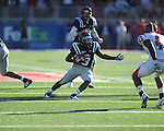Ole Miss running back Jeff Scott (3) rushes at Vaught-Hemingway Stadium in Oxford, Miss. on Saturday, September 4, 2010. Jacksonville State won 49-48 in double overtime.
