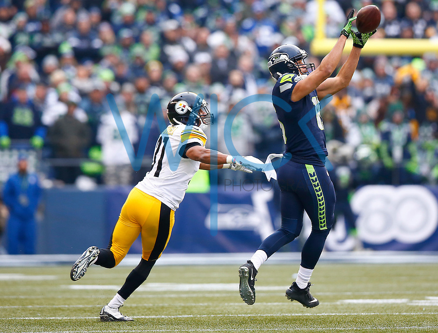 Jermaine Kearse #15 of the Seattle Seahawks catches a pass in front of Ross Cockrell #31 of the Pittsburgh Steelers in the first half during the game at CenturyLink Field on November 29, 2015 in Seattle, Washington. (Photo by Jared Wickerham/DKPittsburghSports)