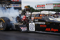 Aug 19, 2016; Brainerd, MN, USA;  A spark plug flies from the engine of the dragster of NHRA top fuel driver Rob Passey as he blows an engine during qualifying for the Lucas Oil Nationals at Brainerd International Raceway. Mandatory Credit: Mark J. Rebilas-USA TODAY Sports