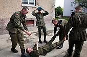 Young Polish soldiers having fun during cigarette break at the military base in Bartoszyce, Poland, May 2008.<br /> (Photo by Piotr Malecki / Napo Images)<br /> Ostatni pobor.Poborowi bawia sie podczas przerwy na papierosa w jednostce w Bartoszycach.5/2008.<br /> Fot: Piotr Malecki / Napo Images