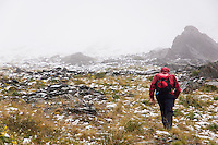 Hiker heading into snow in Mountains, New Zealand
