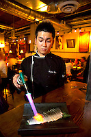 Vancouver, BC, Canada, August 2006. Kodai Uno, owner and chef of Shiru Bay, an 'Izakaya' chopstick bar where the Sake rice wine flows generously. Squeezed in between the Rocky Mountains and the Pacific Ocean, Vancouver has a special feel. Photo by Frits Meyst/Adventure4ever.com