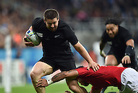 Dane Coles of New Zealand takes on the Tonga defence. Rugby World Cup Pool C match between New Zealand and Tonga on October 9, 2015 at St James' Park in Newcastle, England. Photo by: Patrick Khachfe / Onside Images
