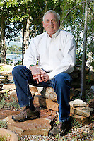 NWA Democrat-Gazette/DAVID GOTTSCHALK  Kirk Dupps sits in the backyard Friday, May 13, 2016, that overlooks Beaver Lake in Eureka Springs. Dupps and his wife Cynthia are the 2016 Color of Hope Chairmen in Northwest Arkansas. Dupps spent 20 years working for Kroger, transitioned to the Phillips Company and became Sr. Vice President of Sales &amp; Marketing of Walton Enterprises grocery operations. He later became head of Sam's Club in the 1990s. He was instrumental in the success of the Phillips Pro-Classic Golf tournament that raised millions for Arkansas charities, including Arkansas Children's Hospital.<br /> Dupps became Commissioner of the Arkansas Game &amp; Fish Commission in 1996. Since 1998, he has  been a senior partner, retail consultant and speaker for Diversified Retail Solutions. In 2005, he cofounded White River Bank and Signature Bank.