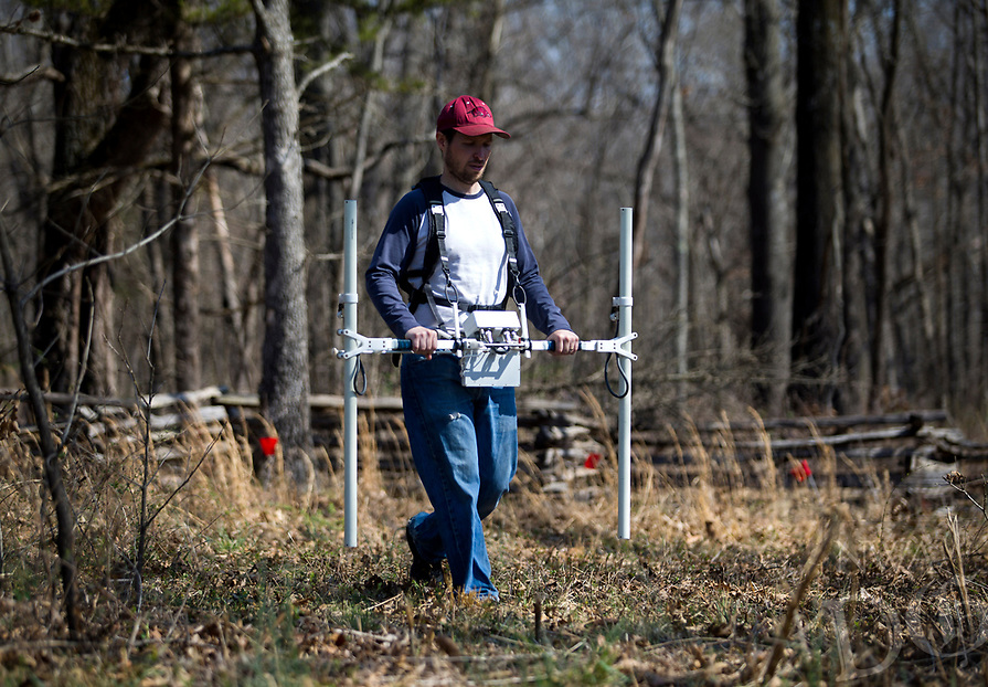 NWA Democrat-Gazette/JASON IVESTER<br /> John Samuelsen (cq) with the Arkansas Archeological Survey uses a gradiometer over a grid in the area of the Leetown Hamlet Thursday, March 23, 2017, at the Pea Ridge National Military Park.