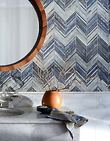 Ombre Chevron, a jewel glass mosaic, shown in Lavastone, Zircon, and Alabaster.