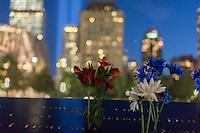 Memorial flowers at the 9/11 Memorial in New York on September 11, 2014 for the13th anniversary of the September 11, 2001 terrorist attacks. (© Richard B. Levine)