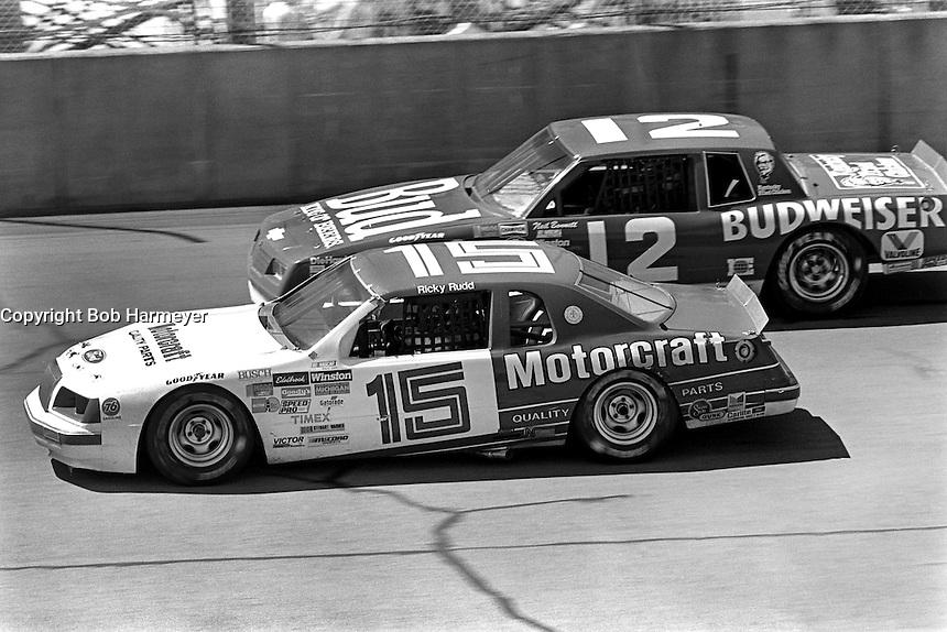 BROOKLYN, MI - AUGUST 11: Ricky Rudd (#15 Bud Moore Ford) leads Neil Bonnett (#12 Junior Johnson Chevrolet) during the Champion Spark Plug 400 NASCAR Winston Cup race at the Michigan International Speedway near Brooklyn, Michigan, on August 11, 1985.