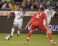LA Galaxy forward Landon Donovan (10) attempts to move past Toronto FC defender Adrian Cann (12). The LA Galaxy and Toronto FC played to a 0-0 draw at Home Depot Center stadium in Carson, California on Saturday May 15, 2010.  .