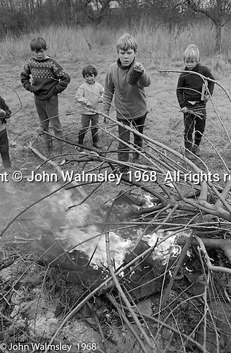 Lighting smokey bonfires in the grounds, Summerhill school, Leiston, Suffolk, UK. 1968.