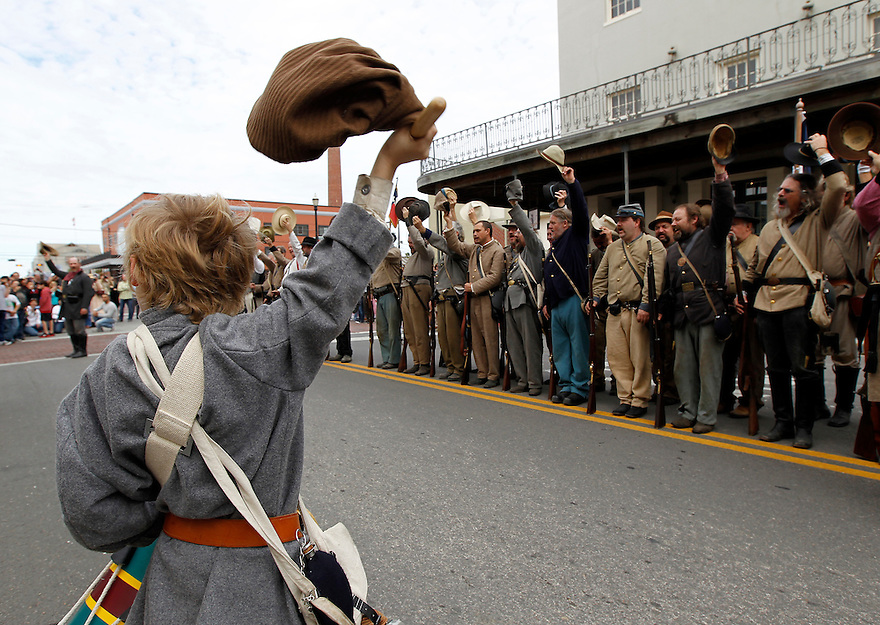 William Waldrip, 7, celebrates with Confederate troops after a Battle of Galveston reenactment on the Strand in Galveston, Texas on Sunday, Jan. 15, 2012. The Battle of Galveston Reenactment was part of a series of events marking the 149th anniversary of the Civil War Battle of Galveston, in which Confederate troops regained control of Galveston Harbor.