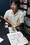 Kakuro creator Maki Kaji talks at his company's office in Tokyo.