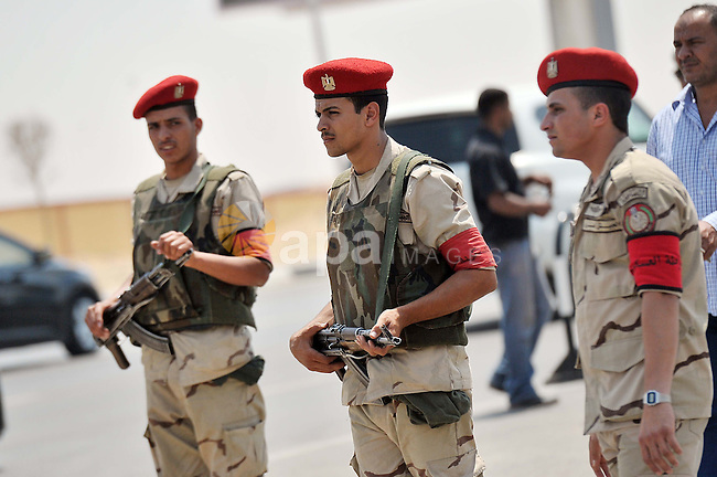Egyptian security forces stand guard outside the Hussin Tantawy Mosque where a funeral of Egypt's Prosecutor General Hisham Barakat, the top judicial official in charge of overseeing the prosecution of thousands of Islamists, including former President Mohammed Morsi, is set  in Cairo, Egypt, Tuesday, June 30, 2015. The Egyptian president promised to speed up proceedings against extremists by amending laws and freeing up the judiciary, a day after the country s top prosecutor was killed in a car bombing. Photo by Amr Sayed