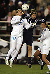 04 December 2009: North Carolina's Courtney Jones (84) and Notre Dame's Rose Augustin (15) challenge for a header. The University of North Carolina Tar Heels defeated the Notre Dame University Fighting Irish 1-0 at the Aggie Soccer Complex in College Station, Texas in an NCAA Division I Women's College Cup Semifinal game.