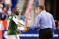 Franck Songo'o (8) of the Portland Timbers talks with interim head coach and general manager Gavin Wilkinson. The New York Red Bulls  defeated the Portland Timbers 3-2 during a Major League Soccer (MLS) match at Red Bull Arena in Harrison, NJ, on August 19, 2012.