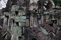 Two stone carved bas relief  Apsaras (celestial maidens) at Ta Prohm, built by Jayavarman VII & part of the  Angkor Wat temple complex - Siem Reap, Cambodia...