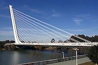 General view of Puente del Alamillo (Alamillo Bridge), Seville, Spain, pictured on January 3, 2007, in the afternoon. Santiago Calatrava designed the bridge for the 1992 Expo. The Cantilever spar cable-stayed bridge across the Guadalquivir River connects the old quarter of Seville with La Cartuja Island. It spans 200 meters and the deck is supported by a single, cabled pylon at a 58 degree angle. Picture by Manuel Cohen.