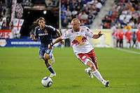 Joel Lindpere (20) of the New York Red Bulls is chased by Frankie Hejduk (6) of the Los Angeles Galaxy. The New York Red Bulls defeated the Los Angeles Galaxy 2-0 during a Major League Soccer (MLS) match at Red Bull Arena in Harrison, NJ, on October 4, 2011.