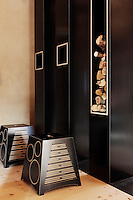 In the entrance hall built-in shelving and cupboards, including a large log store, are faced in black linoleum; the stools have also been designed as percussive instruments which sound when touched