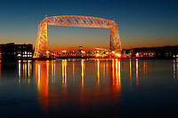 &quot;Twilight Aerial Lift Bridge&quot;<br /> <br /> Duluth's Aerial Lift Bridge on a pre-dawn winter morning. This calm, picturesque morning directly followed a two-day storm with cold temps and high winds off the lake which coated the lakeshore with several inches of ice. Here is the calm after the storm.<br /> <br /> The Aerial Lift Bridge is one of the most-recognized iconic landmarks of Duluth. In a mere 55 seconds, the bridge rises to 138 feet, making it the quickest and biggest lift bridge in the world.