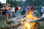 Lynn Gasron, left, and Peter Contesse of Suquamish, Washington, warms themselves by the fire after participating in the 23rd annual Olalla polar bear jump into the Burley lagoon in Olallar, Washington on January 1, 2007. This is the 37th month in a row that the two have jumped into the Puget Sound waters. Jim Bryant Photo. ©2010. ALL RIGHTS RESERVED.