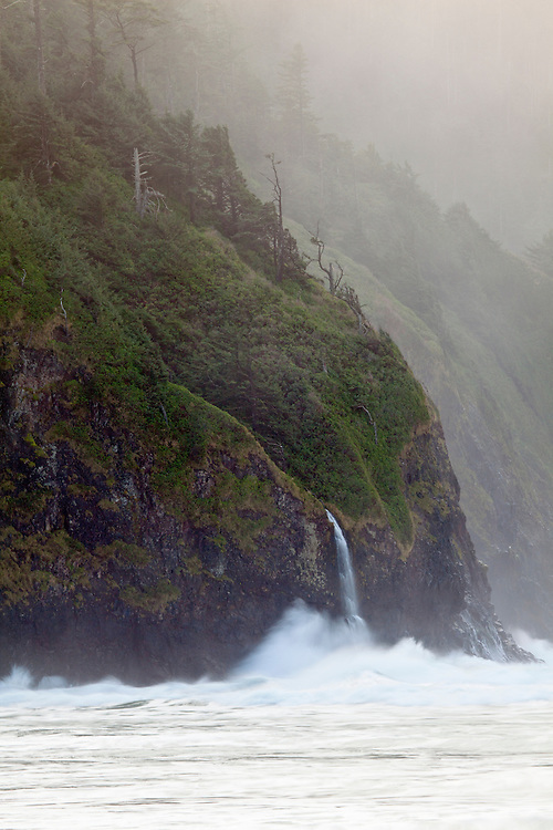 After a winter storm, an ephemeral waterfalls spills into the Pacific Ocean at Cape Lookout State Park, Oregon, USA