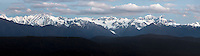 Sunset over Southern Alps with Aoraki Mount Cook, Mount Tasman and Franz Josef Glacier just visible right of centre, Westland Tai Poutini National Park, West Coast, UNESCO World Heritage Area, New Zealand, NZ