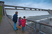 Bonnie Yonek shows her grandchildren, Rachel Rogers, 4, left, and And Andrew Rogers, 6, the flow of water over Hoover Dam  in Columbus, Ohio, following several days of steady rain have flooded the reservoir used as part of the city's water supply.
