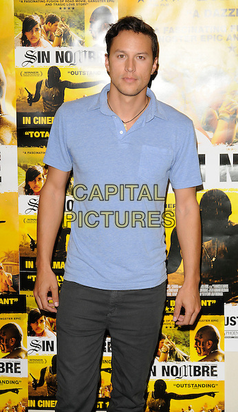 "CARY FUKUNAGA, DIRECTOR .Inside Arrivals at the ""Sin Nombre"" UK Premiere, Soho cinema, London, England, August 11th 2009..half length blue shirt t-shirt polo .CAP/CAN.©Can Nguyen/Capital Pictures"
