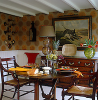 The dining table in the Arts and Crafts-style dining room is laid for dinner