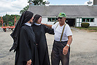 George Sr. greets Mother Mary Elizabeth Koss and Sister Gemma Meade. The Benedictines of nearby Saint Scholastica Priory buy the Hunts' milk for their Fontina cheese, which they hope will become a sustainable source of income. They also pray for Let's Share the Sun.