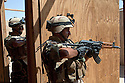 17th Iraqi Division soldiers practice proper clearance of insurgent  filled houses or buildings during training exercises in a mockup building August 30, 2010 at the Joint Security Station (JSS) Deason in Mahmoudiyah, Iraq.