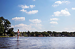 Winsted, CT- 08 September 2015-090815CM19-  Jennifer Tobon of Bristol paddle boards  at Highland Lake in Winsted on Tuesday.  According to the National Weather Service, Wednesday is expected to be mostly sunny, with a high near 88.  Christopher Massa Republican-American