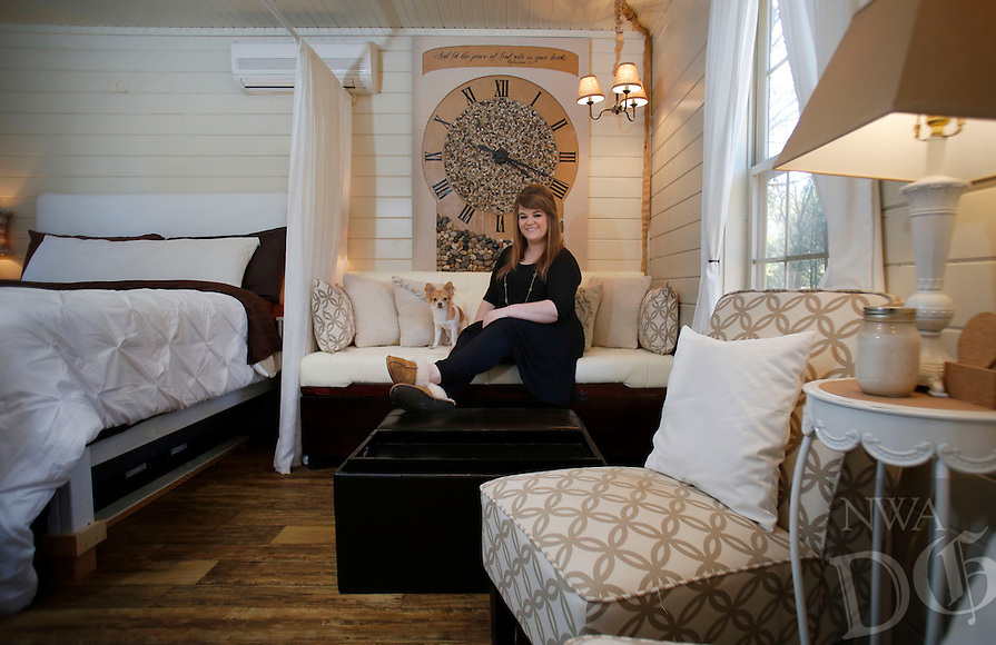 NWA Democrat-Gazette/DAVID GOTTSCHALK  Lauren Sivewright sits in her favorite personal space Thursday, November 10, 2016, the coach in the living area space inside her tiny house in Winslow.