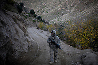 A soldier from Delta-4, 1-26 Infantry patrols on a mission to flush out Taliban fighters in Tantil in the Pesh Valley.