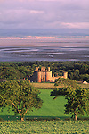 Looking down on Caerlaverock Castle with the Solway Firth and Lake District behind all catching the summer evening sunshine near Dumfries Scotland