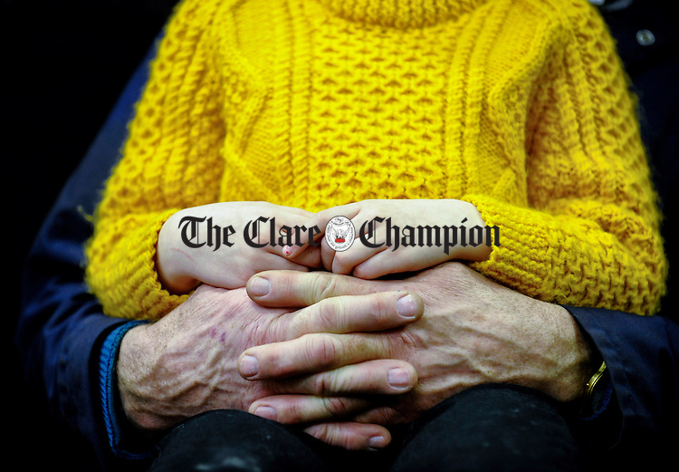 Safe Haven.............Arlene O Sullivan holds the hands of her father Michael at the annual Fatstock Show and Sale at Ennis Mart. Photograph by John Kelly.
