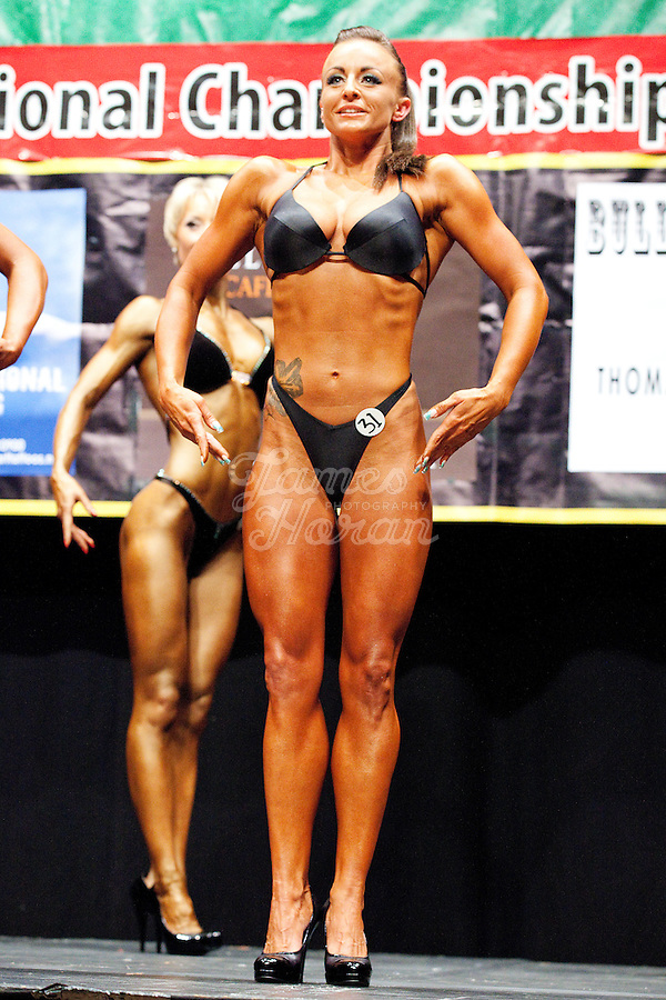 23/10/2010. Irish female physique and figure fitness national championships.  Contestant Katarina Cienka is pictured onstage during the female figure fitness category as part of the 2010 RIBBF national bodybuilding championships at the University of Limerick Concert Hall, Limerick, Ireland. Picture James Horan.