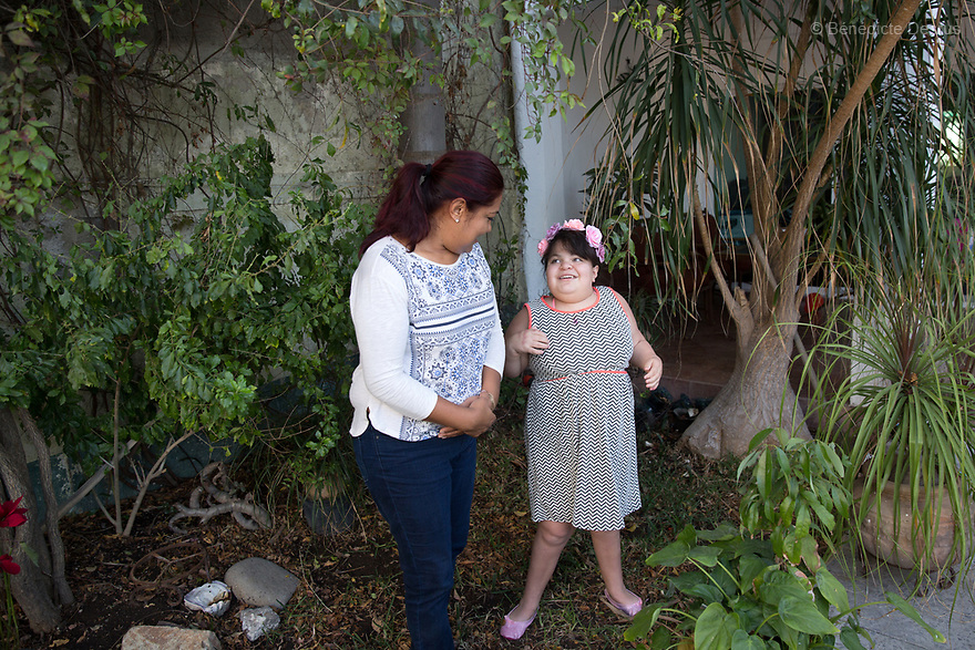 "Ana Ximena Navarro (R) and her aunt Gabriela Rios Ballesteros (L), are pictured in Guadalajara, Mexico on February 22, 2017. Ximena was diagnosed as an infant with Hurler syndrome. Hurler syndrome is the most severe form of mucopolysaccharidosis type 1 (MPS1), a rare lysosomal storage disease, characterized by skeletal abnormalities, cognitive impairment, heart disease, respiratory problems, enlarged liver and spleen, characteristic facies and reduced life expectancy. Ximena was being given enzyme replacement therapy (ERT) when she was 19 months old, and she was suddenly able to eat and sleep. She is now 12, and has normal hormonal development for her age, although some mental delay, according to her father. ""Without the treatment, she would have died from all the complications — untreated, children have a very bad quality of life and typically die before they are seven"", her father says. Photo credit: Bénédicte Desrus"
