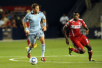 Luke Sassano (blue) Sporting KC, Christain Nazarit  Chicago Fire...Sporting KC were held to a scoreless tie with Chicago Fire in the inauguarl game at LIVESTRONG Sporting Park, Kansas City, Kansas.