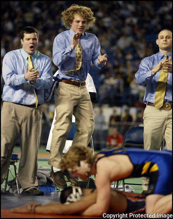 Michael Johnson, center, jumps for joy as  his younger brother Brad wrestles his way to a third consecutive state championship on Saturday, Feb, 17, 2006 at the Mat Classic XIX held in Tacoma, Washington. (Jim Bryant Photo)
