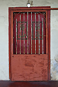 An old door of a restored heritage house in the UNESCO heritage town - Georgetown of Penang, Malaysia. Photo: Sanjit Das/Panos