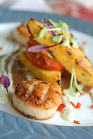 Pan Seared Scallops with Grilled Polenta with a Wild Mushroom and Tomato Ragout.
