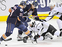 San Antonio Rampage's Scott Timmins (32) falls under Oklahoma City Barons' Tanner House (21) and Triston Grant as he chases the puck ahead of teammate Roman Derlyuk, right, during the second period of an AHL hockey game, Thursday, May 10, 2012, in San Antonio. (Darren Abate/pressphotointl.com)