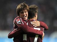 FUSSBALL   1. BUNDESLIGA  SAISON 2011/2012   30. Spieltag FC Augsburg - VfB Stuttgart           10.04.2012 Jubel nach dem Tor zum 1:2 Martin Harnik (re, ) mit Gotoku Sakai (VfB Stuttgart)