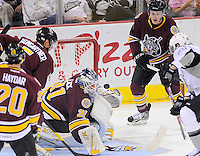 Chicago Wolves goaltender Eddie Lack (31) makes a save on San Antonio Rampage's Bill Thomas, right, during the first period of an AHL hockey game, Thursday, April 19, 2012, in San Antonio. (Darren Abate/pressphotointl.com)