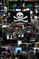 A pirate flag flies over gamers at one of the world's largest convention of computer enthusiasts, simply called 'The Gathering'. Over five thousand young people come together each Easter, some travelling long distances, each carrying their own computer equipment to the massive Vikingship sports hall in the city of Hamar. The main activity is online gaming. Many hardly see daylight or taste fresh air for the entire five days as they compete with their fellow geeks for cash prizes and the honour of being the best.