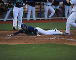 North Carolina-Wilmington's Thomas Pope (7) scores on a wild pitch vs. Ole Miss at Oxford-University Stadium in Oxford, Miss. on Saturday, February 25, 2012. Ole Miss won 6-4.