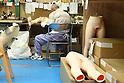 June 23, 2010- Tokyo, Japan - A worker connects a foot of one of Orient Industy's Love Dolls at the factory in Tokyo, Japan, on June 23, 2010. Orient Industry is a 33-year-old company which is number one in Japan for producing over 1,000 Love Dolls annually, ranging in price from ¥90,000 to ¥700,000.
